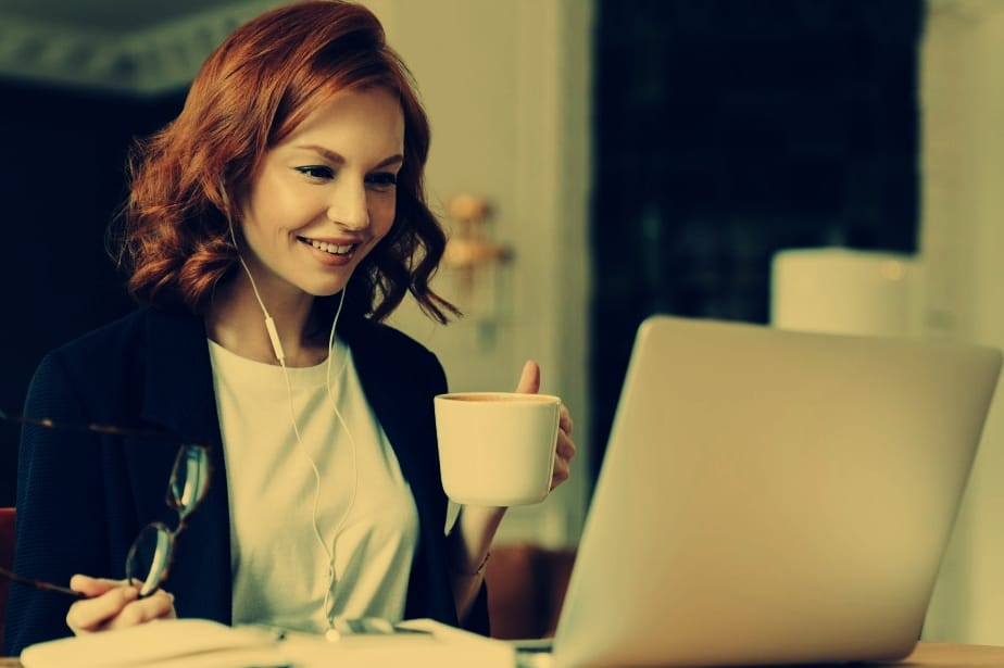 red haired woman working
